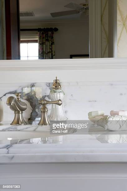 Detail of white marble bathroom counter and mirror