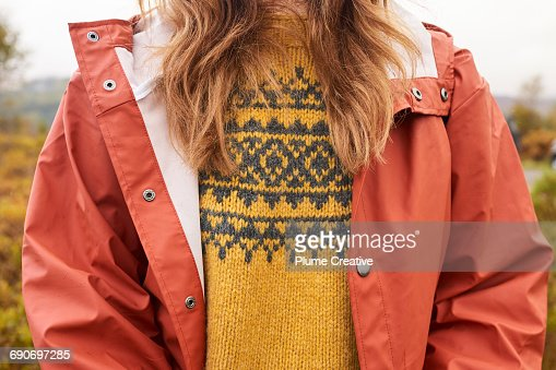 Detail of woman's jumper and waterproof jacket