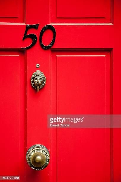Detail of wooden red door in Portobello Road, London (United Kingdom)