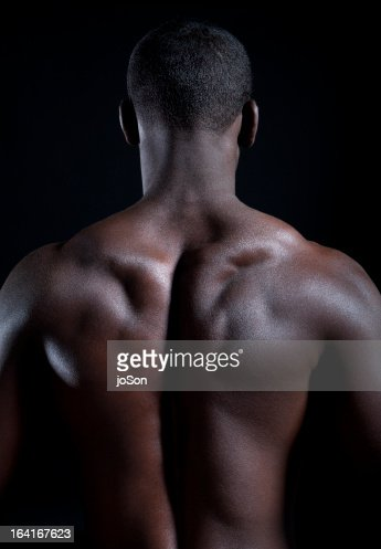 Detail of young muscular man, back muscles : Stock Photo