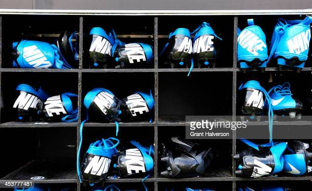 Detail photo of extra Nike cleats behind the Carolina Panthers bench during play against the Tampa Bay Buccaneers at Bank of America Stadium on...