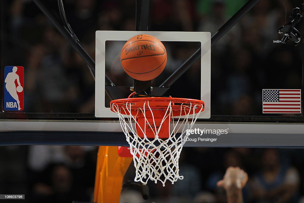 A detail photo of the ball as it falls through the rim as the Denver Nuggets face the New York Knicks at the Pepsi Center on November 16 2010 in...