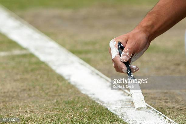 Detail photo of the baseline being painted as a groundsmen prepare centre court for play ahead of day three of the ATP Aegon Open Nottingham at...