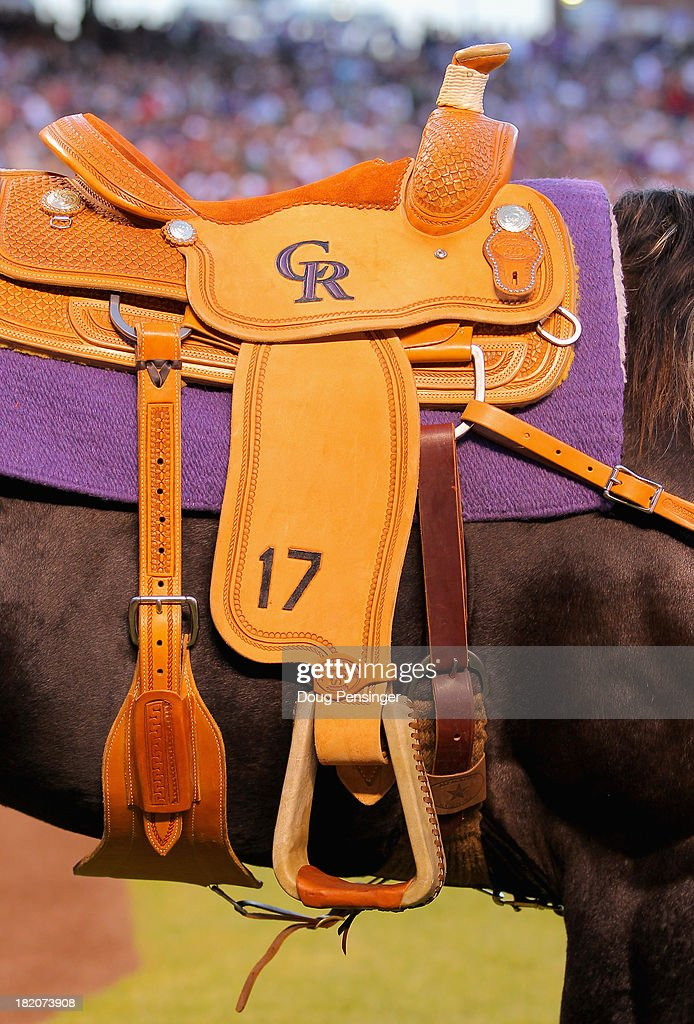 A detail photo of the custom saddle given to <a gi-track='captionPersonalityLinkClicked' href=/galleries/search?phrase=Todd+Helton&family=editorial&specificpeople=200735 ng-click='$event.stopPropagation()'>Todd Helton</a> #17 of the Colorado Rockies on the Tobiano Gelding Paint Horse named 'A Tru Bustamove' as a retirement present from the organzation during pregame ceremonies as he prepares to play his final home game at Coors Field on September 25, 2013 in Denver, Colorado.
