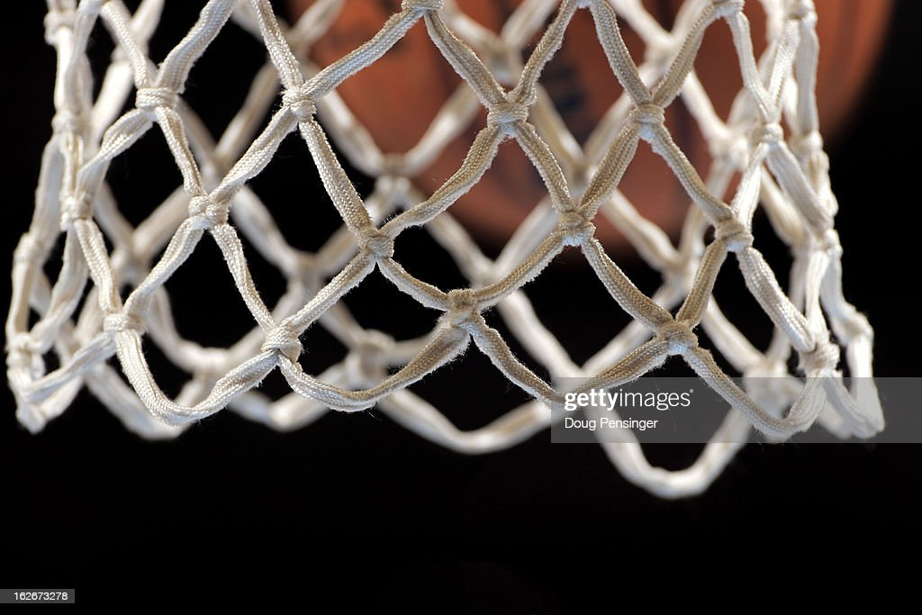 A detail photo of the net as a ball flys toward the basket during warm ups as the Los Angeles Lakers face the Denver Nuggets at the Pepsi Center on...