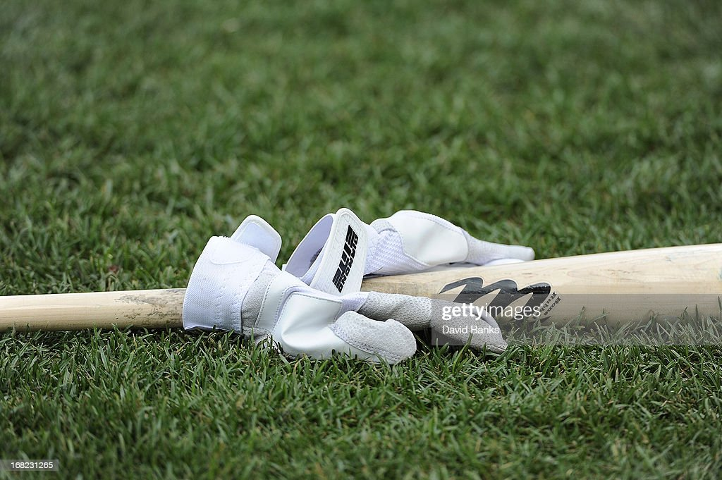 A detail shot of a bat and batting gloves on May 1, 2013 at Wrigley Field in Chicago, Illinois.