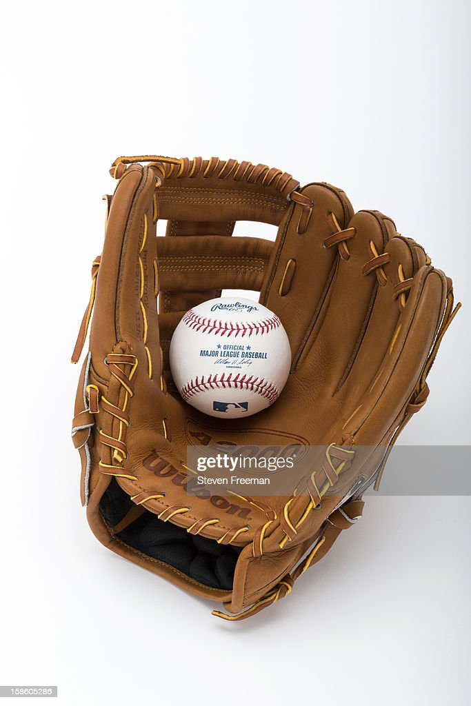 A detail shot of a Rawlins baseball and Wilson A2000 glove, the Official Ball and Glove of Major League Baseball, photographed on December 19, 2012 in New York City.