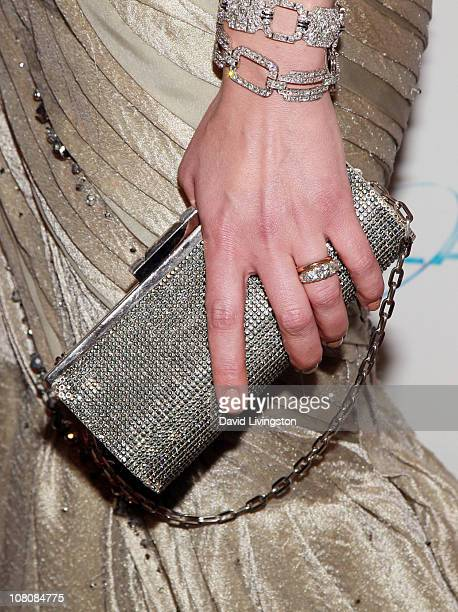 A detail shot of actress Milla Jovovich's accessories as she arrives at The Weinstein Company And Relativity Media's 2011 Golden Globe Awards Party...