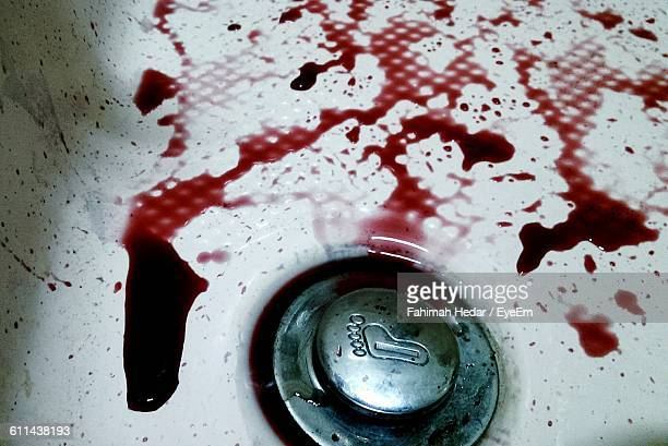 Detail Shot Of Blood By The Drain In Washbasin