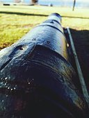 Detail Shot Of Cannon On Grassland