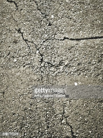 Detail Shot Of Cracked Road