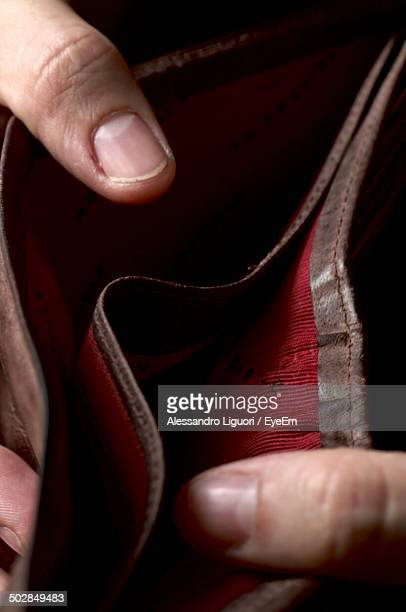 Detail shot of hands holding empty wallet