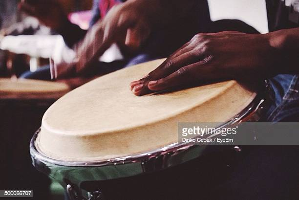 Detail shot of hands playing the drum