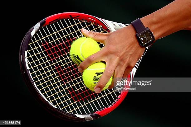 Detail shot of Kei Nishikori of Japan's racquet and slazenger tennis balls during his Gentlemen's Singles third round match against Simone Bolelli of...