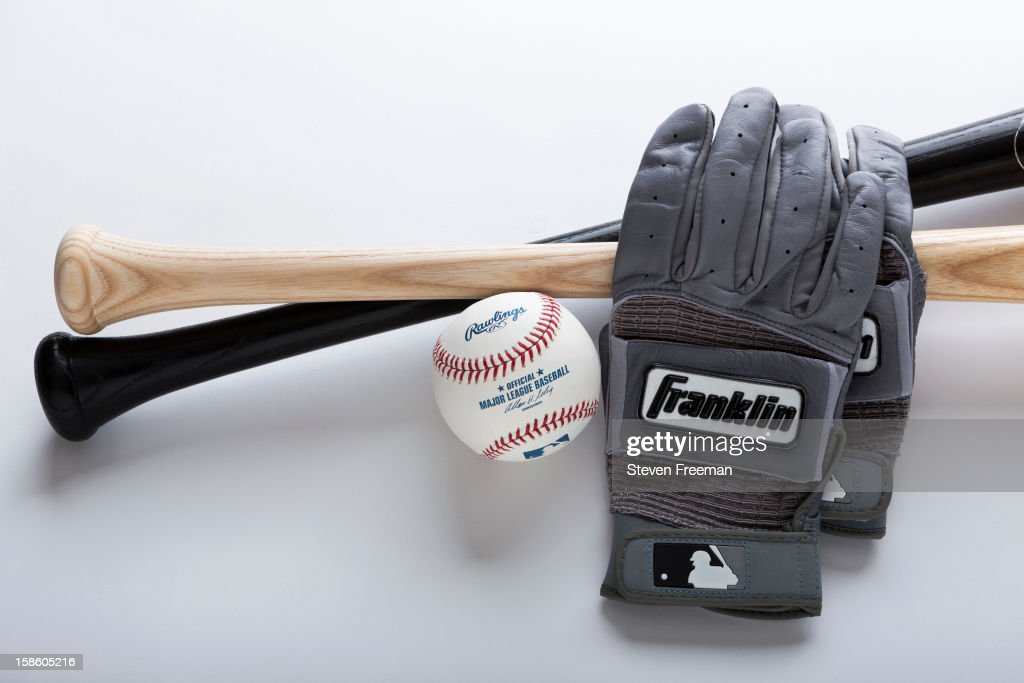 A detail shot of Louisville Slugger Bats, Rawlins Ball, and Frankiln batting gloves, the Official Bat, Ball and Batting gloves of Major League Baseball, photographed on December 19, 2012 in New York City.