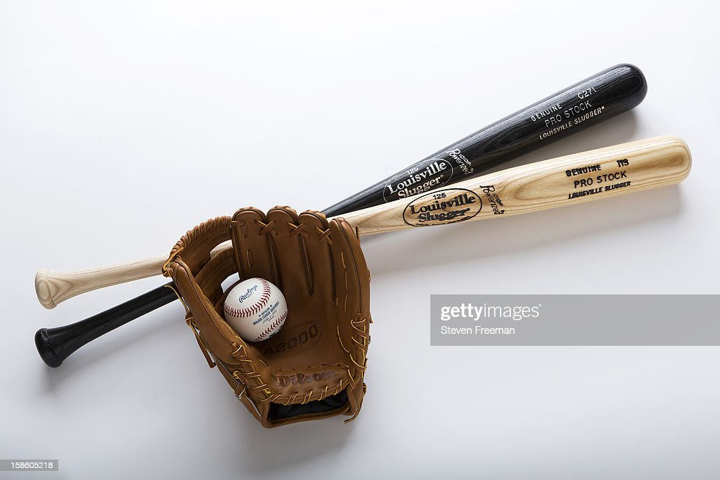 A detail shot of Louisville Slugger Bats, Rawlins Ball, and Wilson A2000 glove, the Official Bat, Ball and Glove of Major League Baseball, photographed on December 19, 2012 in New York City.