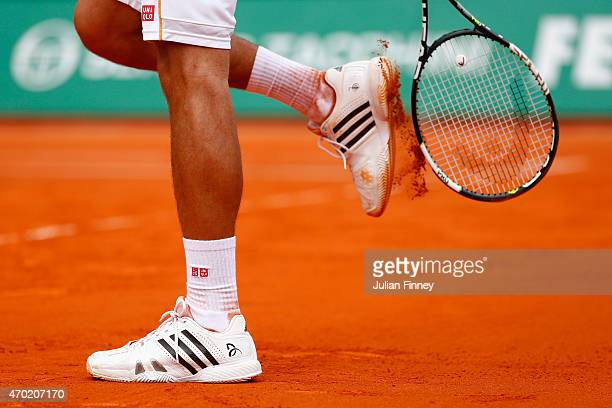 A detail shot of Novak Djokovic of Serbia clearing his shoes of clay against Rafael Nadal of Spain in the semi finals during day seven of the Monte...
