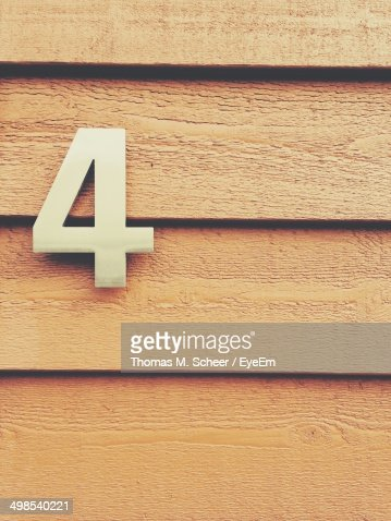 Detail shot of number 4 on wooden wall