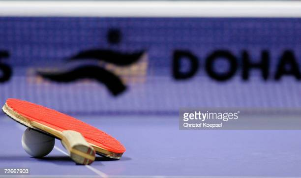 A detail shot of racquet and ball is shown on the table during the Women's Team round one at 15th Asian Games Doha 2006 at AlArabi Indoor Hall...