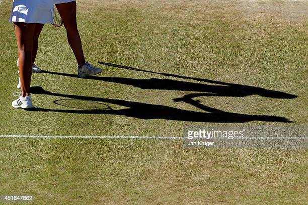 Detail shot of shadows of Freya Christie and Isabelle Wallace of Great Britain during a Girls' Doubles second round match against Naiktha Bains of...