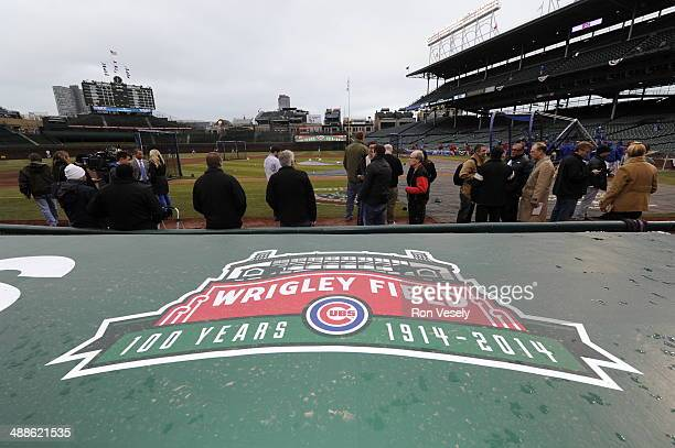 A detail shot of the 100th year anniversary logo of Wrigley Field on the Cubs dugout prior to the Opening Day game between the Chicago Cubs and...