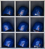 A detail shot of the batting helmets in the helmet rack before the game between the Philadelphia Phillies and the New York Mets at Citi Field on...