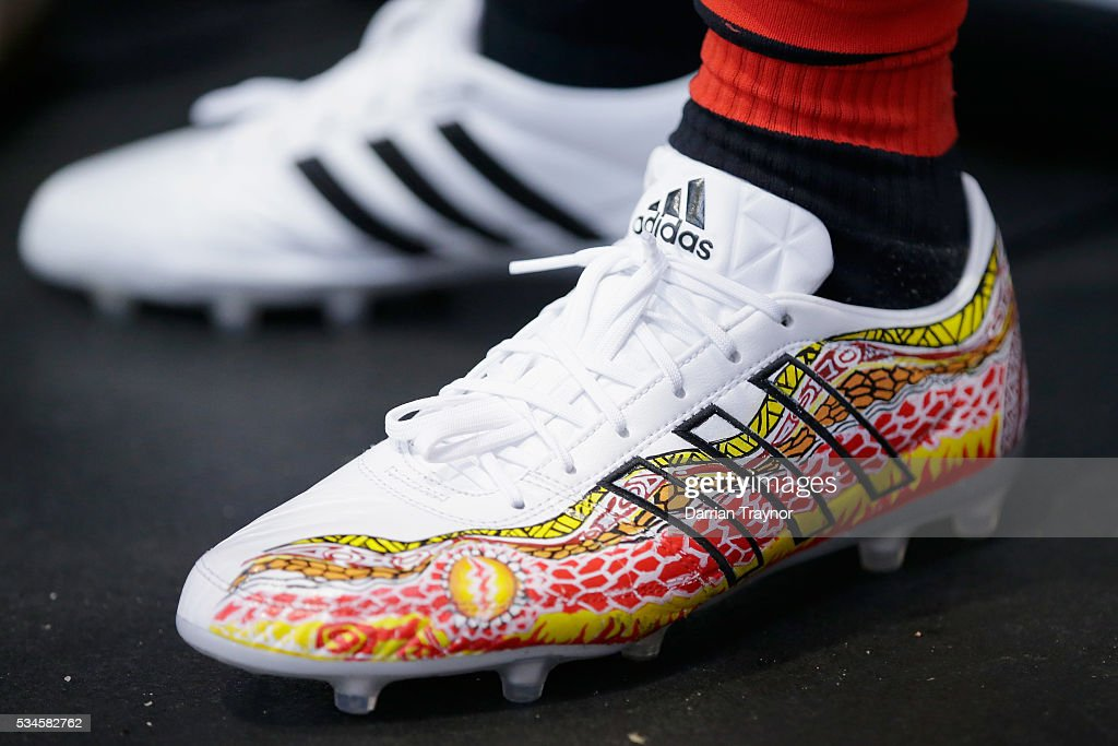 A detail shot of the boots of Courtenay Dempsey of the Bombers during an Essendon Bombers AFL media opportunity at True Value Solar Centre. Courtenay will wear the boots featuring an Indigenous design by his uncle Jimmy Hill during the 'Dream TIme' game on Saturday night. May 27, 2016 in Melbourne, Australia.