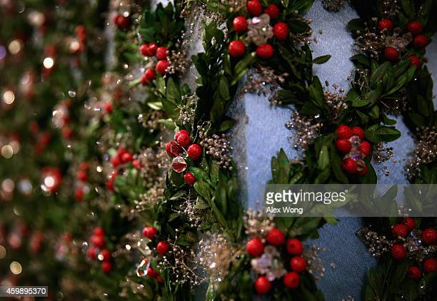 Detail shot of the holiday decorations on a column at the East Wing Hallway of the White House December 3 2014 in Washington DC The first lady hosted...