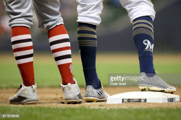 A detail shot of the socks worn by Matt Carpenter of the St Louis Cardinals and Keon Broxton of the Milwaukee Brewers in the fifth inning at Miller...