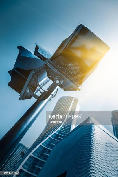 detail shot of traffic light against cityscape