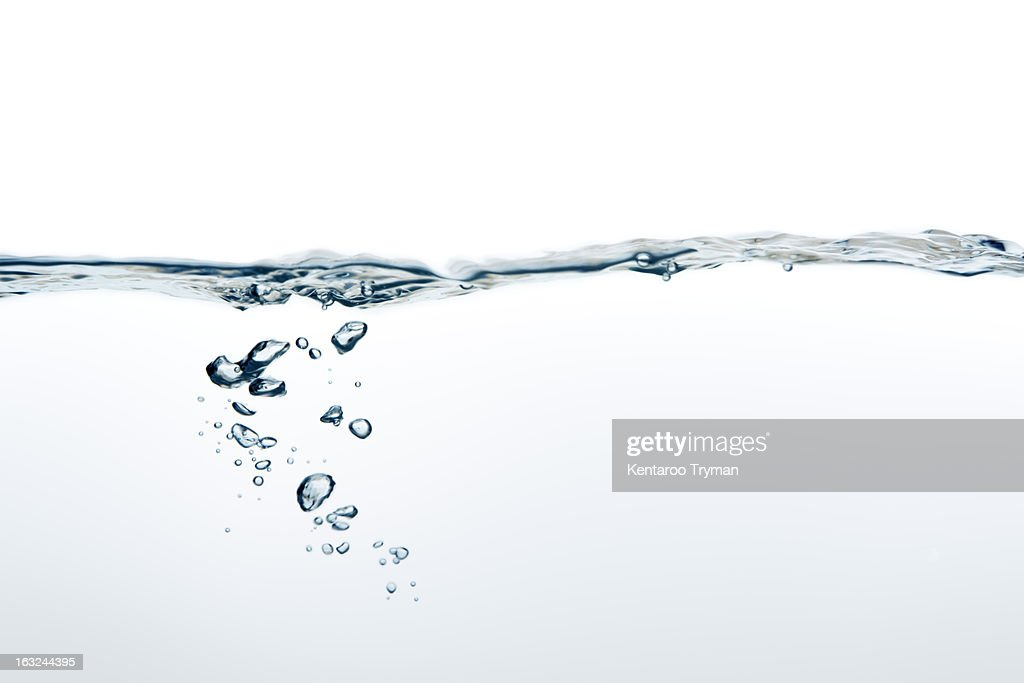 Detail shot of water splash with bubbles against white background