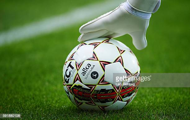 Detail view of a goalkeepers glove touching the Alka Superliga Select match ball during the UEFA Europa League playoff 1st leg match between FC...