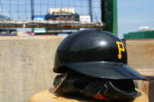A detail view of a Pittsburgh Pirates helmet and glove during the game against the Atlanta Braves at PNC Park on July 29 2004 in Pittsburgh...