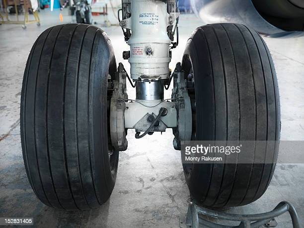 Detail view of airplane wheels in hangar