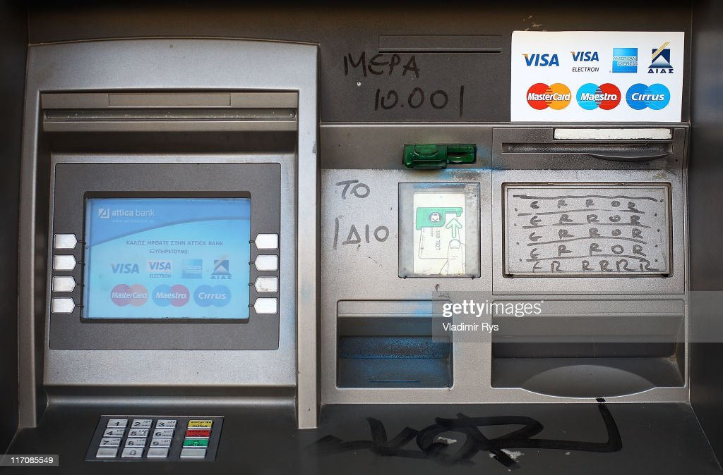 A detail view of an ATM machine with a sign saying 'Day number 10.001 and still nothing has changed' as a reaction on the politic-economical situation in Greece is pictured on June 21, 2011 in Athens, Greece. Eurozone finance ministers are currently seeking to find a solution to Greece's pressing debt problems, including the prospect of the country's inability to meet its financial obligations unless it gets a fresh, multi-billion Euro loan by July 1. Greece's increasing tilt towards bankruptcy is rattling worldwide financial markets, and leading economists warn that bankruptcy would endanger the stability of the Euro and have dire global consequences.