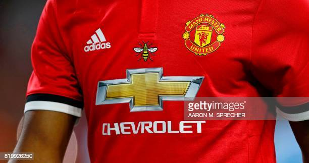 A detail view of bee is seen on a Manchester United jersey during the International Champions Cup soccer match against Manchester City at NRG Stadium...