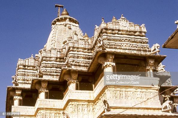 Detail view of elephant sculptures and embellished carvings decorating the walls and peaked roofs of the Jagdish Temple Udaipur Rajasthan located in...
