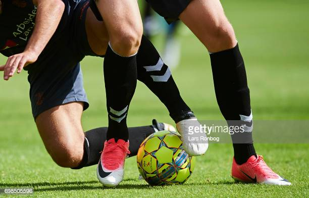 Detail view of football shoes and a ball competing during the Brondby IF training session at Brondby Stadion on June 20 2017 in Brondby Denmark