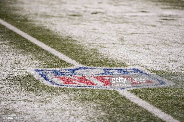 Detail view of NFL logo surrounded by snow during the game between the Buffalo Bills and the Pittsburgh Steelers on December 11 2016 at New Era Field...