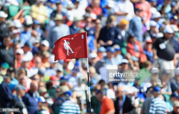 A detail view of the 18th green flag which features an image of Arnold Palmer during the final round of the 2017 US Open at Erin Hills on June 18...