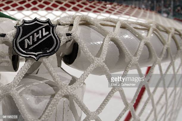 A detail view of the goal net protective padding = and NHL embroiderred logo on the ice prior to the start of the game between the Florida Panthers...