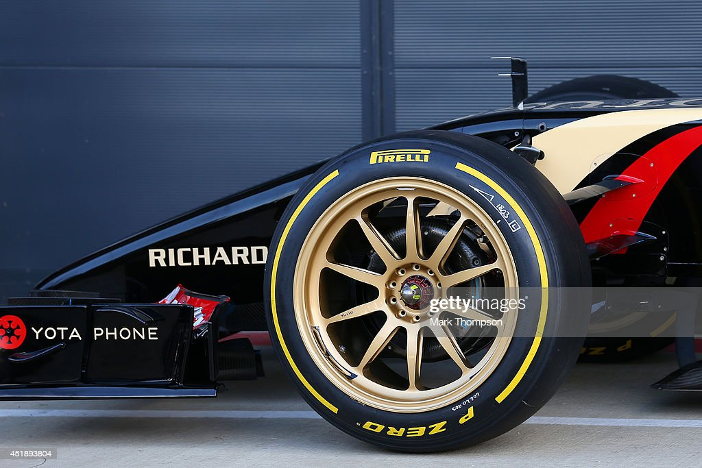 A detail view of the new 18-inch Pirelli wheels fitted on a Lotus before demonstration runs during day two of testing at Silverstone Circuit on July 9, 2014 in Northampton, England.