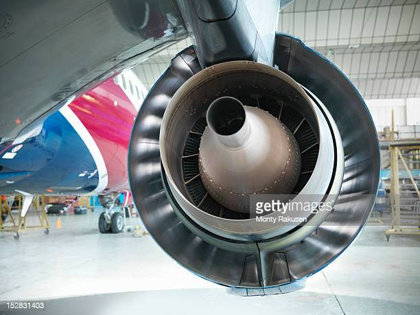 Detail view of the rear of jet engine of airplane in hangar