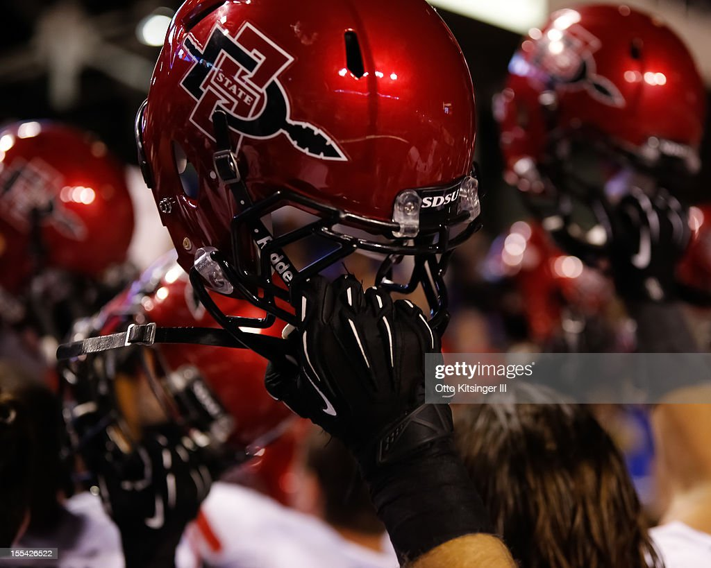 Detail view of the San Diego State Aztecs holding aloft their helmets after winning against against the Boise State Broncos at Bronco Stadium on November 3, 2012 in Boise, Idaho.