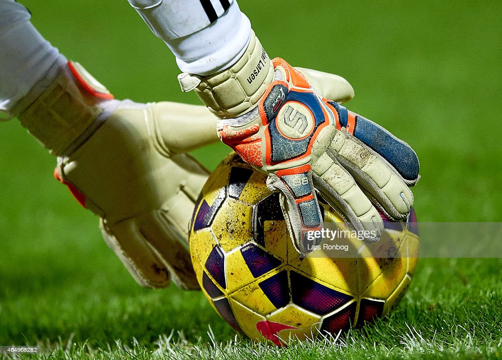 Detail view of the Select gloves of Goalkeeper Nicolai Larsen of AaB Aalborg and the Nike match ball during the Danish Alka Superliga match between...