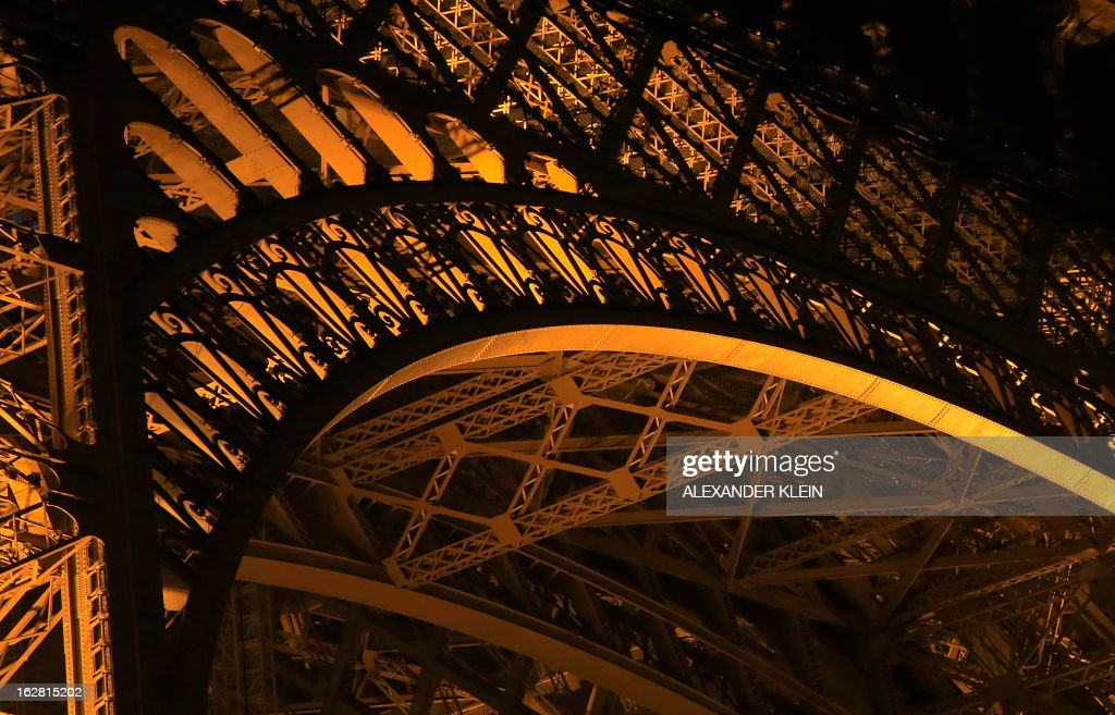 A detail view of the The Eiffel tower's steel structure is seen on a foggy night in Paris on February 28, 2013. The tower was completed in 1889 and it's current total height is 324 meters.