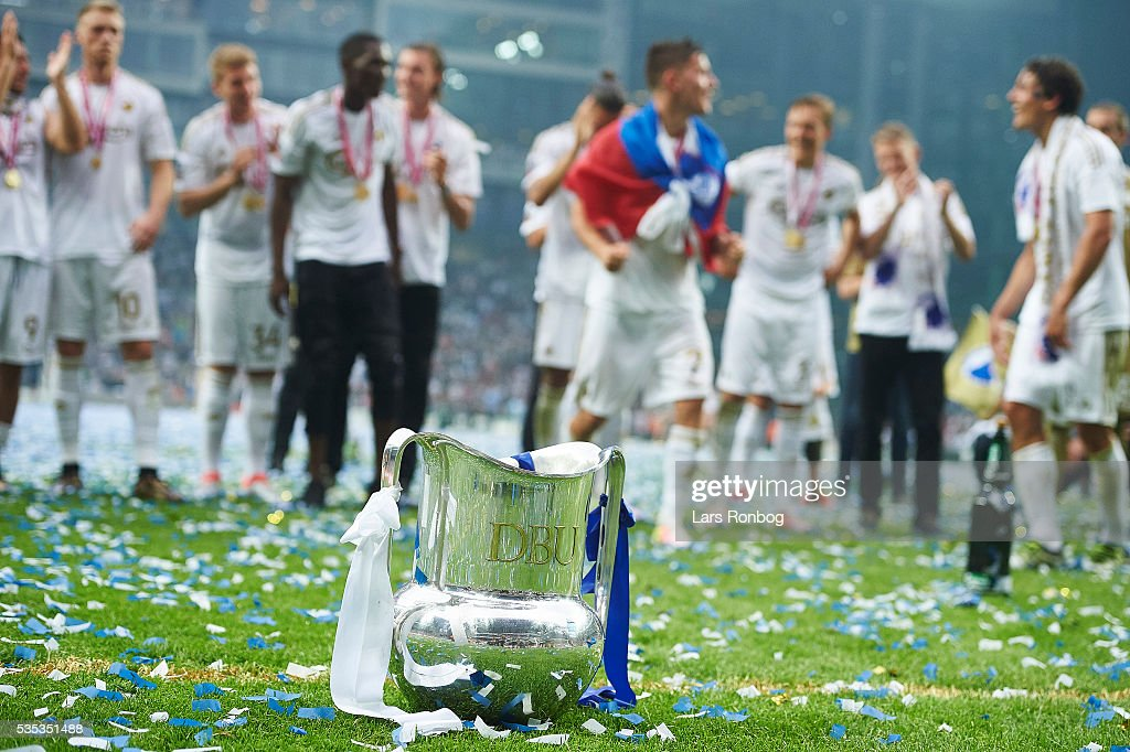 Detail view of the trophy and the players of FC Copenhagen celebrating as Danish Champions 2015/2016 after the Danish Alka Superliga match between FC Copenhagen and AGF Aarhus at Telia Parken Stadium on May 29, 2016 in Copenhagen, Denmark.