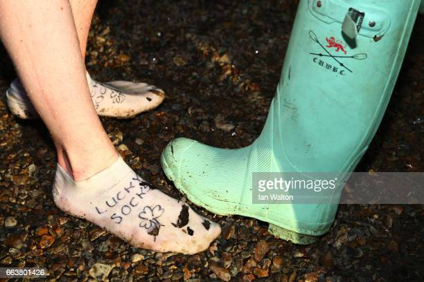 A detail view showing a Cambridge Wellington boot and a pair of 'Lucky Socks' after the women's Cancer Research UK Boat Race on April 2 2017 in...