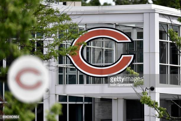 A detailed exterior view of the Chicago Bears logo at the entrance of Halas Hall during the Bears minicamp workouts on June 15 2017 at Halas Hall in...