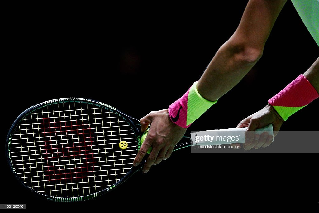 A detailed look at the ball, wristband and racquet of <a gi-track='captionPersonalityLinkClicked' href=/galleries/search?phrase=Andrey+Kuznetsov+-+Tennis+Player&family=editorial&specificpeople=5892238 ng-click='$event.stopPropagation()'>Andrey Kuznetsov</a> of Russia before serving to Milos Raonic of Canada during day 2 of the ABN AMRO World Tennis Tournament held at the Ahoy Rotterdam on February 10, 2015 in Rotterdam, Netherlands.